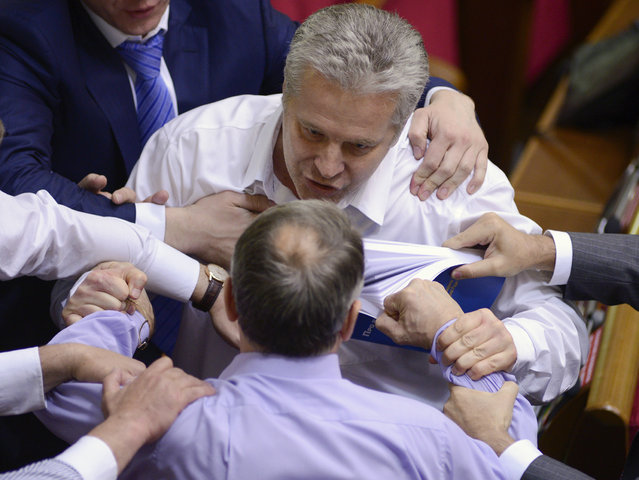 A deputy from the pro-presidential Party of the Regions (bottom) clashes with an opposition deputy and his colleagues, who attempt to disrupt a parliament session while demanding Ukraine's President Viktor Yanukovich to deliver his address in person, in Kiev, June 6, 2013. (Photo by Reuters/Stringer)