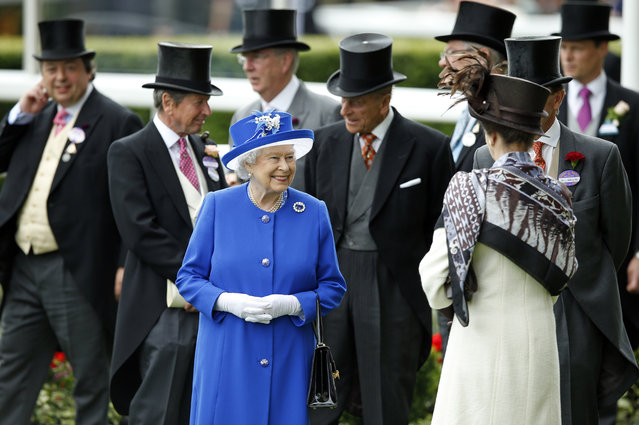 Britain's Queen Elizabeth II smiles as she walks in the paddock on the second day of Royal Ascot horse racing meet at Ascot, England, Wednesday, June 17, 2015. Royal Ascot is the annual five day horse race meeting that Britain's Queen Elizabeth II attends every day of the event. (AP Photo/Alastair Grant)