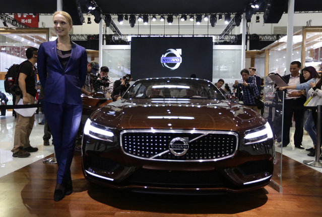 A model poses with a Volvo concept car at Auto China 2014 in Beijing April 20, 2014. China is set to surpass the United States to become Volvo Car Group's biggest market in 2014 with sales of at least 80,000 cars in the world's largest auto market. (Photo by Jason Lee/Reuters)
