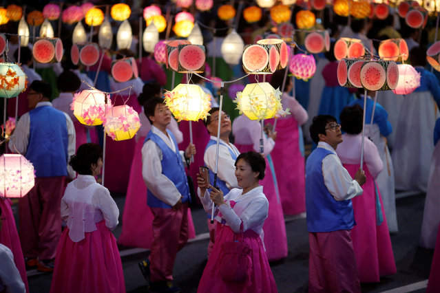 A Buddhist takes a selfie as they march with lanterns during a lotus lantern parade in celebration of the upcoming birthday of Buddha in Seoul, South Korea, May 7, 2016. (Photo by Kim Hong-Ji/Reuters)