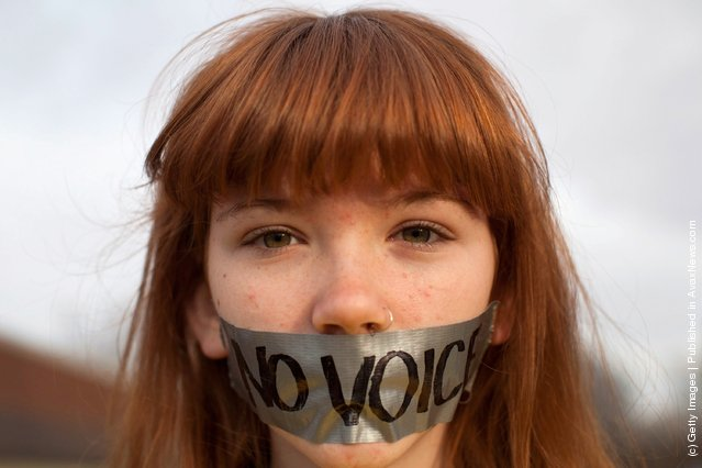 Frankie Hughes, 14, a protestor affiliated with the Occupy Wall Street movement, demonstrates outside the Iowa Democratic Party headquarters
