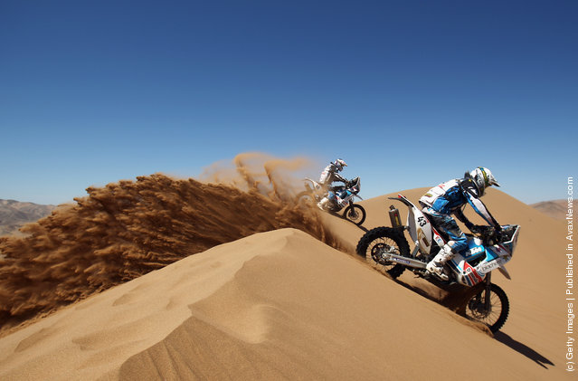 Michael Pisano of France and MP Concept rides over a sand dune during stage seven of the 2012 Dakar Rally