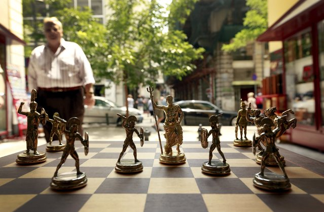 Chess pieces depicting Greek gods and Spartan soldiers on display in a shop in Athens, Greece July 11, 2015. Skeptical European finance ministers gathered on Saturday to decide whether to negotiate a third bailout for Greece after Prime Minister Alexis Tsipras won lawmakers' backing for painful austerity measures his leftist party was elected to prevent. (Photo by Cathal McNaughton/Reuters)