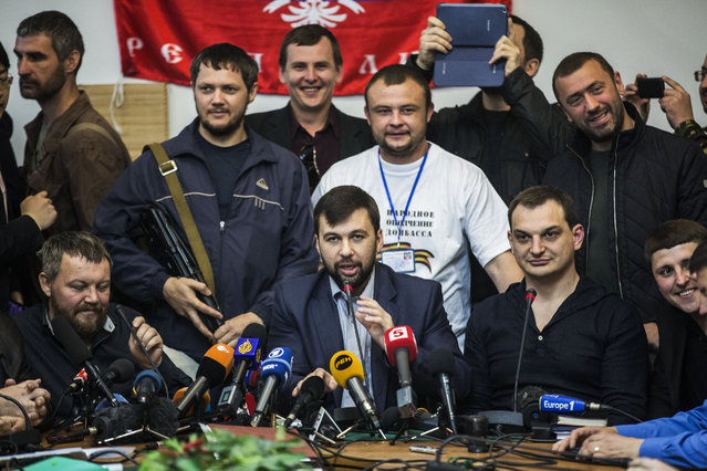The head of the elections commission of the so-called Donetsk People's Republic, Denis Pushilin, center foreground, is seen during a press conference to inform the media about the referendum at the occupied administration building in Donetsk, Ukraine, Thursday, May 8, 2014. Today, the pro-Russia insurgency in eastern Ukraine decided Thursday to go ahead with Sunday's referendum on autonomy despite a call from Russian President Vladimir Putin to delay it. (Photo by Manu Brabo/AP Photo)