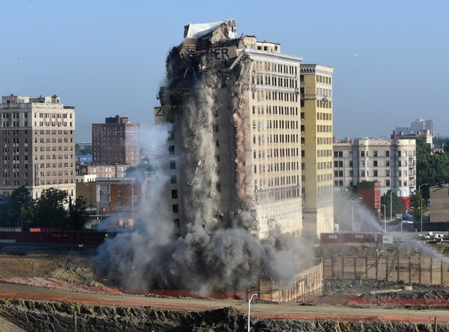 In this Saturday, July 11, 2015 photo, Detroit's Park Avenue Hotel is imploded to make way for a new hockey arena and entertainment distric. (Photo by Max Ortiz/Detroit News via AP Photo)