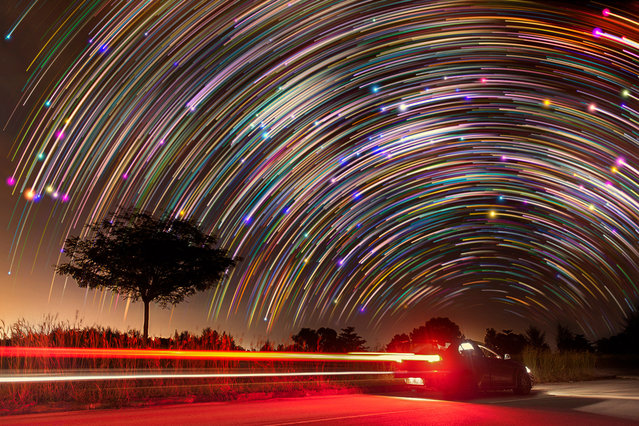 Star trails photographed by Justin Ng at the backdrop of a car in Singapore. These astonishing images of night sky are captured by Singapore based photographer Justin Ng. The pictures were taken between November 2013 to January 2014. It show's star trail caused by the earth's rotation and also can be achieved by zooming the DSLR lens inward or outward in small steps using a dedicated motorized zooming device. (Photo by  Justin Ng/Barcroft Media)