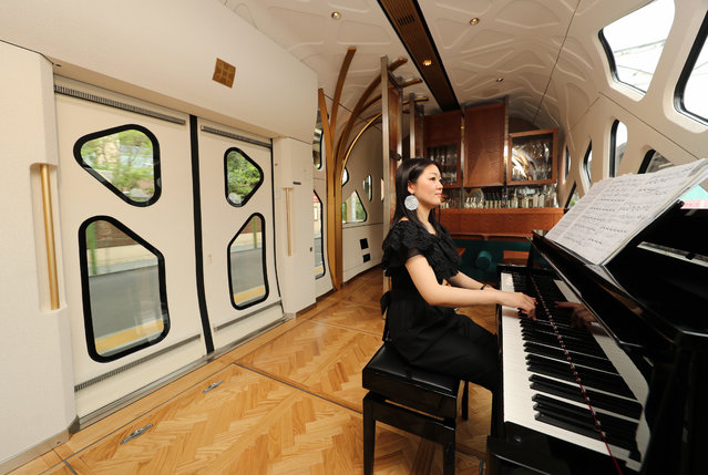 "Piano is played at the lounge of the JR East's ""Train Suite Shiki-Shima"" during the press preview on April 26, 2017 in Tokyo, Japan. (Photo by The Asahi Shimbun via Getty Images)"