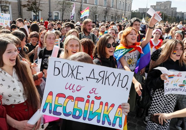 """Participants attend the KharkivPride march in support of the LGBT community in Kharkiv, Ukraine September 15, 2019. The banner reads """"Thank God that I'm a lesbian"""". (Photo by Gleb Garanich/Reuters)"""