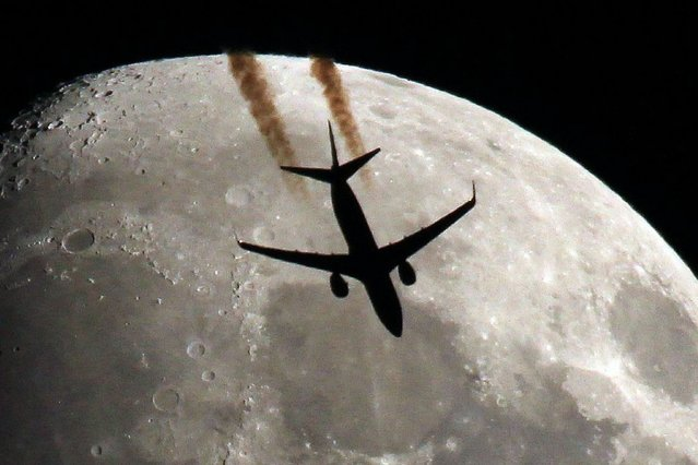 This plane looks like it's bound for the moon as it shoots across the sky. Photographer Sebastien Lebrigand was impressed he could even see the lights on the jet's wings in this stunning silhouette. (Photo by Sebastien Lebrigand/Solent News)
