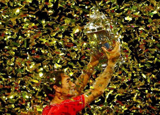 Switzerland's Roger Federer celebrates with the trophy after winning the Swiss Indoors Basel final against Australia's Alex de Minaur in Switzerland on October 27, 2019. (Photo by Arnd Wiegmann/Reuters)