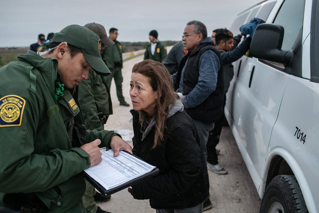 U.S. Border Patrol agents detain undocumented immigrants caught near a section of privately-built border wall under construction on December 11, 2019 near Mission, Texas. The hardline immigration group We Build The Wall is funding construction of the wall on private land along the Rio Grande, which forms the border with Mexico. The group, led by former Trump strategist Stephen Bannon claims to have raised tens of millions of dollars in a GoFundMe drive to build sections of wall along stretches of the southwest border with Mexico. (Photo by John Moore/Getty Images)