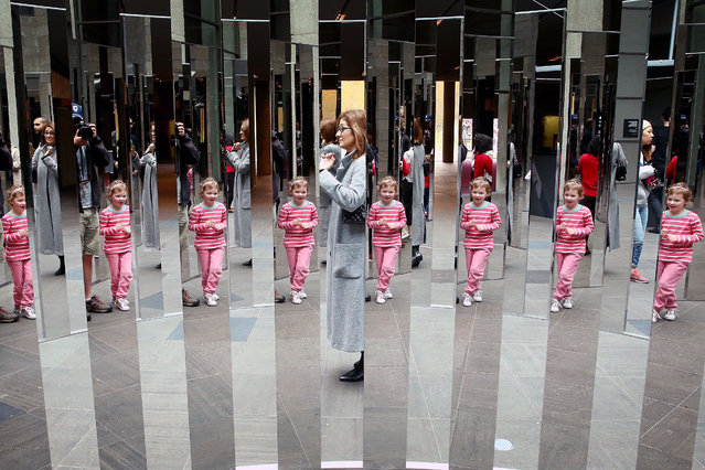 "People wander through a maze of mirrored panels that create many reflections at the National Gallery of Victoria International on June 7, 2016 in Melbourne, Australia. The installation, titled ""Semicircular Space"" is by the Danish contemporary artist Jeppe Hein and will occupy the NGV International Federation Court from 4 June – 16 September 2016. (Photo by Scott Barbour/Getty Images)"