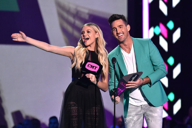 Singer-songwriter Kelsea Ballerini and singer-songwriter Jake Owen onstage during the 2016 CMT Music awards at the Bridgestone Arena on June 8, 2016 in Nashville, Tennessee. (Photo by Mike Coppola/Getty Images for CMT)
