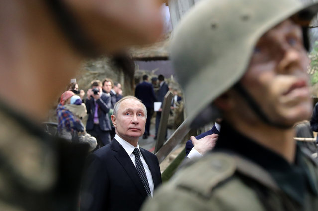 """Russian President Vladimir Putin, left, visits the exhibition  """"Memory speaks. The road through the war"""" in St. Petersburg, Russia, Saturday, January 18, 2020. Putin attended events marking the 77th anniversary of the break of Nazi's siege of Leningrad. The Red Army broke the nearly 900-day blockade of the city on January 19, 1943 after fierce fighting. (Photo by Mikhail Klimentyev, Sputnik, Kremlin Pool Photo via AP Photo)"""