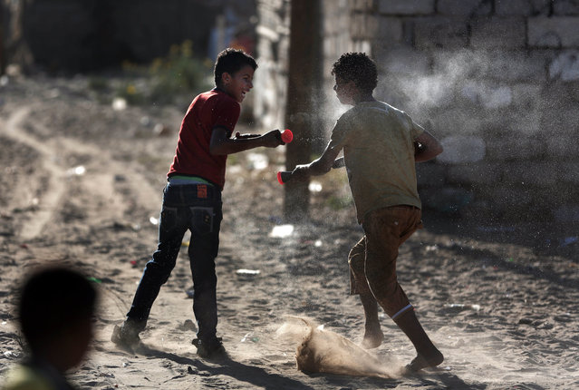 In this Monday, June 20, 2016 photo, Palestinian boys play with water toys in el-Zohor slum on the outskirts of Khan Younis refugee camp, southern Gaza Strip. (Photo by Khalil Hamra/AP Photo)