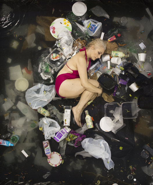 Susan surrounded by seven days of her own rubbish in Pasadena, California. If you've never thought about how much rubbish you throw away an honest photographic series will open your eyes. Men, women, couples and families with young children have been photographed lying on their backs surrounded by a week's worth of their own rubbish – from old cartons of milk, used nappies and even tampons. (Photo by Gregg Segal/Barcroft Media)