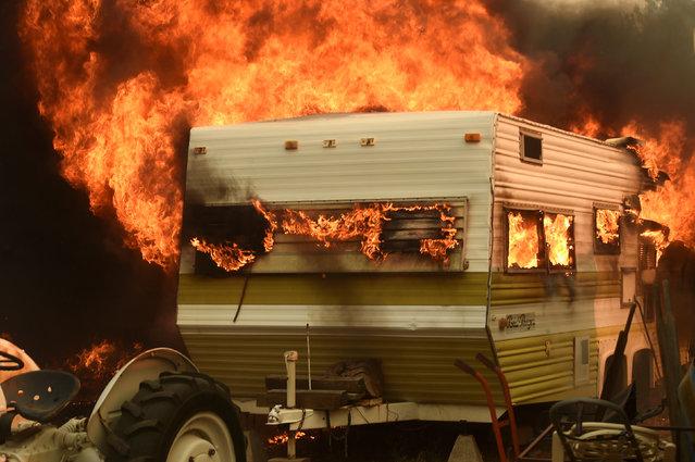 Flames from the Erskine Fire engulf a trailer near Weldon, California, U.S. June 24, 2016. (Photo by Noah Berger/Reuters)