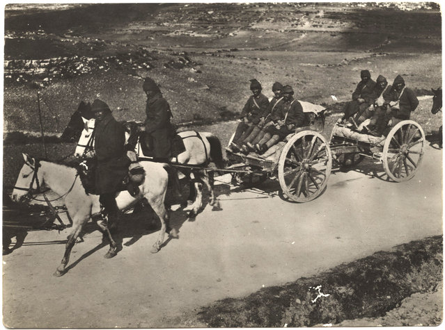 Turkish soldiers ride in horse-drawn carts, still a frequently used means of transportation at the time. (Photo by Dr. P.A. Smithe/National World War I Museum, Kansas City, Mo.)