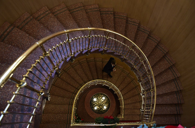 A man walks the stairway inside the Nobel Institute before a news conference of the 2016 Nobel Peace prize laureate  in Oslo on December 9, 2016. (Photo by Tobias Schwarz/AFP Photo)