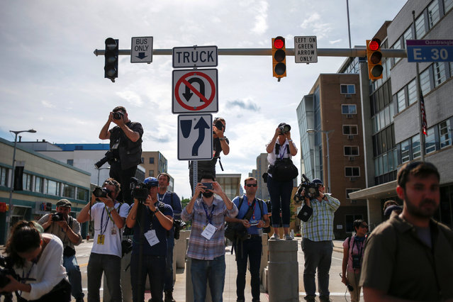 """Journalists focus their cameras towards a protest march by various groups, including """"Black Lives Matter"""" and """"Shut Down Trump and the RNC"""", ahead of the Republican National Convention in Cleveland, Ohio, U.S., July 17, 2016. (Photo by Adrees Latif/Reuters)"""