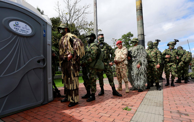 Soldiers stand in line outside portable toilets during a military parade to celebrate the 206th anniversary of Colombia's independence in Bogota, Colombia, July 20, 2016. (Photo by John Vizcaino/Reuters)