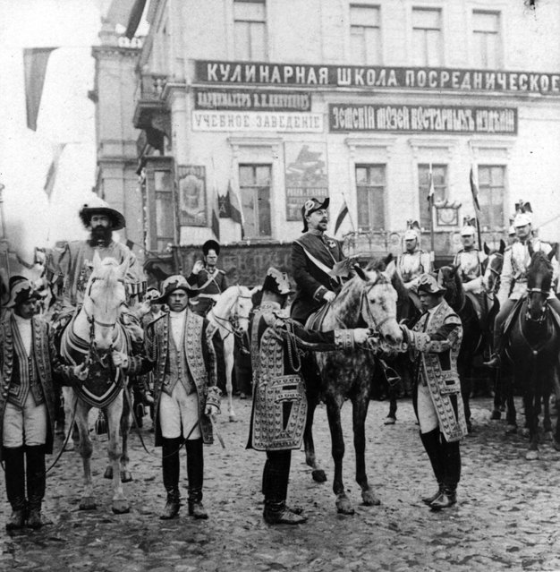 Heralds ride on horse-back through the streets of Moscow proclaiming the forthcoming coronation of Tsar Nicholas II, 1896.