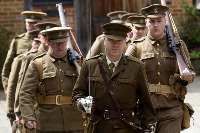 Theatre nurse Ciaran Dukes (C) portraying a Captain in the Royal Army Medical Corps marches with other re-enactors depicting World War One drills at the Eden Valley Museum at Edenbridge in south east England May 10, 2014. (Photo by Luke MacGregor/Reuters)