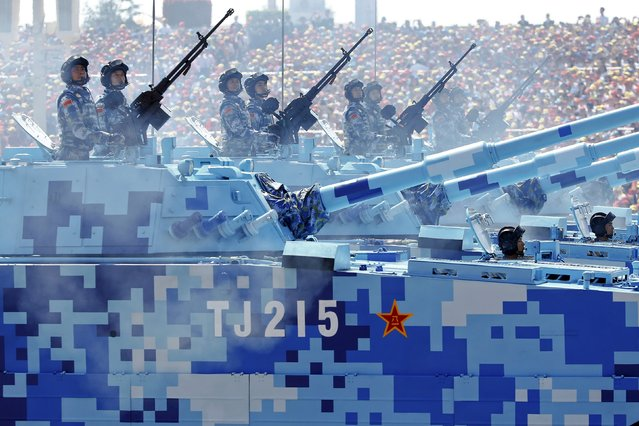 China's People's Liberation Army (PLA) navy soldiers roll on their armoured vehicles to Tiananmen Square during the military parade marking the 70th anniversary of the end of World War Two, in Beijing, China, September 3, 2015. (Photo by Damir Sagolj/Reuters)