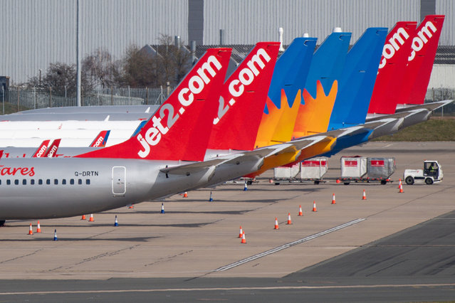 Grounded planes at Birmingham International Airport in England on March 23, 2020. The government are advising that all but essential travel should be avoided as to limit the spread of coronavirus. (Photo by Jacob King/PA Images via Getty Images)