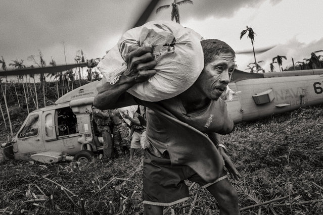 The Eye of the Storm by Sean Sutton – Typhoon Haiyan hit the Philippines on 8 November 2013 killing more than 6,000 people. Haiyan, known locally as Yolanda, had sustained winds of 315kph, making it the strongest typhoon ever to reach landfall. Much of the city of Tacloban on Leyte Island was directly in the path of the storm and was completely devas- tated by the intense winds and a storm surge between five and eight meters high. (Photo by Sean Sutton/MAG/Panos Pictures)