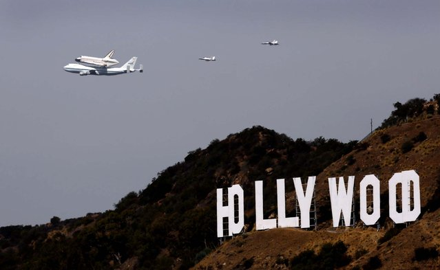 The space shuttle Endeavour passes the iconic Hollywood sign in Los Angeles. (Photo by Al Seib/Los Angeles Times/MCT)