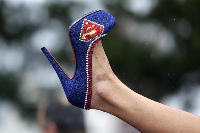 Miss Illinois Marisa Buchheit displays her shoe during the Miss America Shoe Parade at the Atlantic City boardwalk, Saturday, September 13, 2014, in Atlantic City, N.J. (Photo by Julio Cortez/AP Photo)