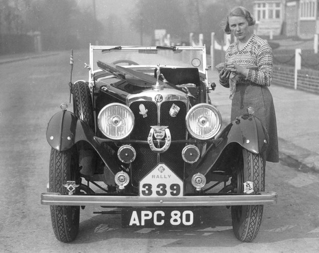 British Rally driver, Kitty Brunell polishing her AC sports car after winning a Hastings RAC rally in it, circa 1935. (Photo by General Photographic Agency)