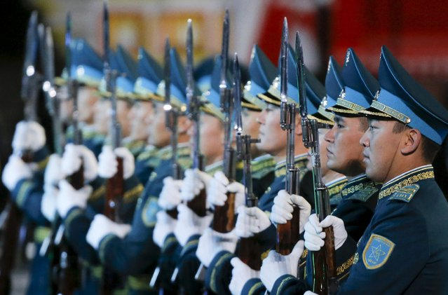 "Members of Kazakhstan's squadron of Honor Guard perform during the ""Spasskaya Tower"" international military music festival at Moscow's Red Square, Russia, September 10, 2015. (Photo by Maxim Shemetov/Reuters)"