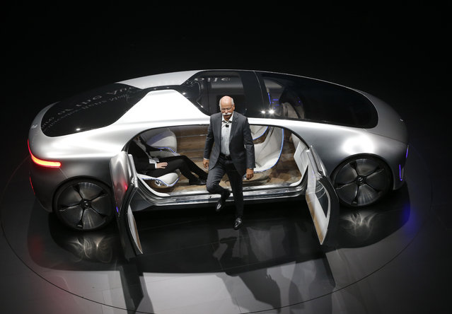 Daimler CEO Dieter Zetsche leaves an autonomous driving vehicle during an event of the Daimler group on the eve of the Frankfurt Auto Show IAA in Frankfurt, Germany, Monday, September 14, 2015. (Photo by Michael Probst/AP Photo)