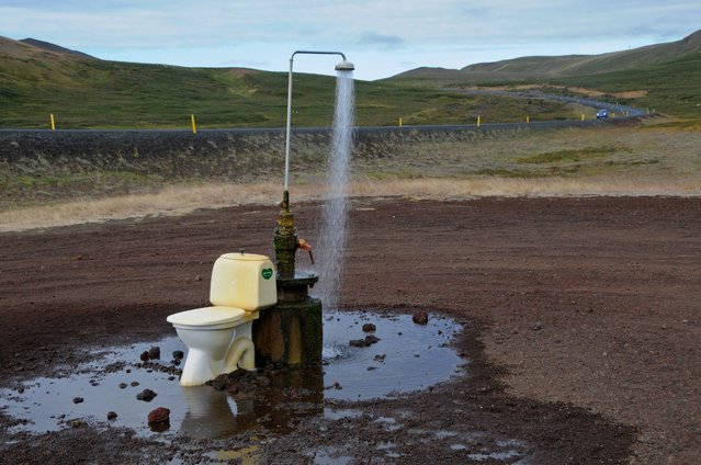 An open-air toilet and a hot spring shower are seen in the middle of nowhere on the road to the Krafla geothermal power station and lava fields, near Reykjahlid and Lake Myvatn in northeastern Iceland, on August 19, 2012. (Photo by Mariana Suarez/AFP Photo)