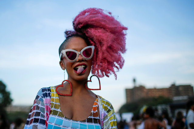 A woman takes part in the Annual Afropunk Music festival in the borough of Brooklyn in New York, U.S., August 27, 2016. (Photo by Eduardo Munoz/Reuters)