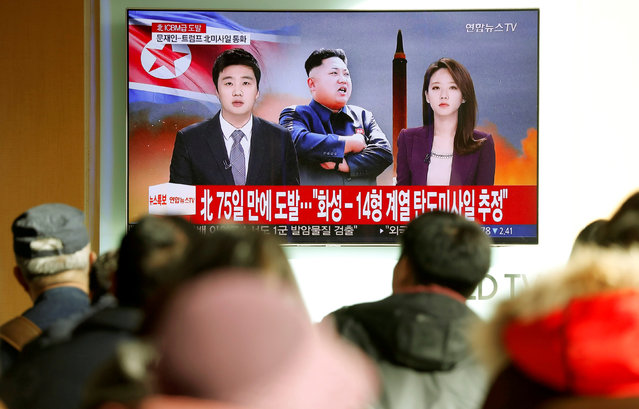 People watch a TV broadcasting a news report on North Korea firing what appeared to be an intercontinental ballistic missile (ICBM) that landed close to Japan, in Seoul, South Korea, November 29, 2017. (Photo by Kim Hong-Ji/Reuters)