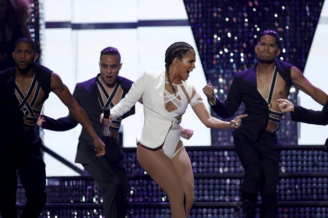 Jennifer Lopez (C) performs with dancers during the second night of the 2015 iHeartRadio Music Festival at the MGM Grand Garden Arena in Las Vegas, Nevada September 19, 2015. (Photo by Steve Marcus/Reuters)