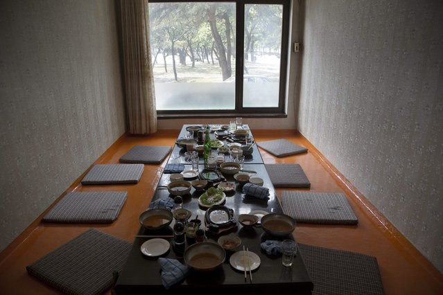 In this June 15, 2014 photo, the remains of lunch sits on a restaurant table in the city of Wonsan, North Korea. (Photo by David Guttenfelder/AP Photo)