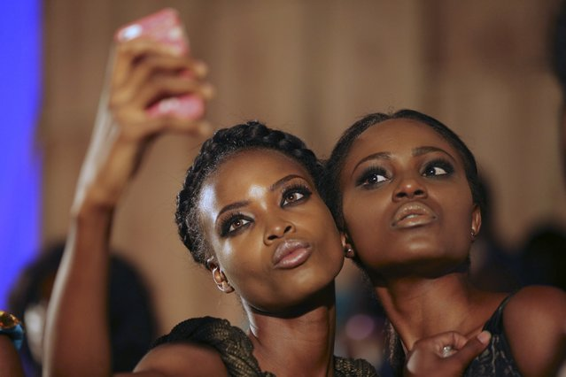 Models take a selfie backstage during Lagos fashion and design week October 29, 2014. Picture taken October 29, 2014. (Photo by Akintunde Akinleye/Reuters)