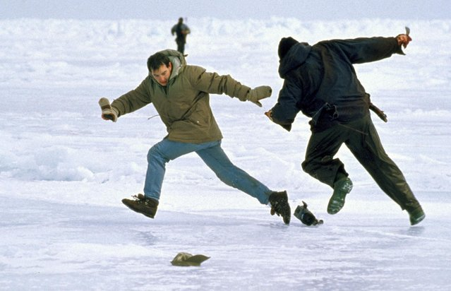"In this 1997 photo released by the International Fund for Animal Welfare, a seal hunter, right, threatens a cameraman with a knife during the filming of a seal hunt in the Gulf of St. Lawrence, Canada. ""Huntwatch"", a documentary by the organization about the fight to end commercial seal hunts, premieres in September 2016 on Discovery. The producers say it includes grainy but powerful archive footage that had languished in the basement of the group's headquarters on Cape Cod for nearly five decades. (Photo by Richard Sobol/IFAW via AP Photo)"