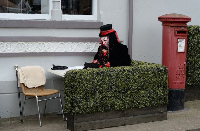 A Goth sits at a cafe; Whitby Goth Weekend, Britain, on November 2, 2014. (Photo by Nigel Roddis/Rex Features)