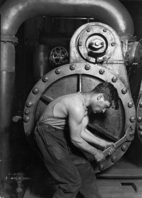 """Power house mechanic working on steam pump, 1920"". (Photo by Lewis Hine)"
