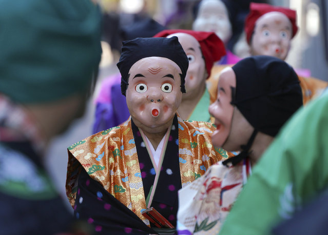 Artists wearing Japanese traditional clown masks march during the First Konpira Festival at Kotohiragu shrine in Tokyo Wednesday, January 10, 2018. The shrine is dedicated to sailors and seafaring. (Photo by Eugene Hoshiko/AP Photo)