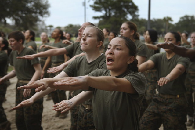 Female Marine recruits are disciplined with some unscheduled physical training in the sand pit outside their barracks during boot camp February 27, 2013 at MCRD Parris Island, South Carolina. Female enlisted Marines have gone through recruit training at the base since 1949. About 11 percent of female recruits who arrive at the boot camp fail to complete the training, which can be physically and mentally demanding. On January 24, 2013 Secretary of Defense Leon Panetta rescinded an order, which had been in place since 1994, that restricted women from being attached to ground combat units. About six percent of enlisted Marines are female. (Photo by Scott Olson/AFP Photo)