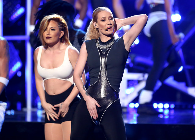 Iggy Azalea perform at the 42nd annual American Music Awards at Nokia Theatre L.A. Live on Sunday, November 23, 2014, in Los Angeles. (Photo by Matt Sayles/Invision/AP Photo)