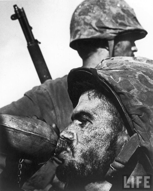"Photographer W. Eugene Smith's picture of a Marine drinking from his canteen during 1944's Battle of Saipan is as iconic a war picture as any ever made. In fact, when the U.S. Postal Service released a ""Masters of American Photography"" series of commemorative stamps in 2002, Smith was included – and this image was chosen as representative of his body of work. (Photo by W. Eugene Smith/Time & Life Pictures)"
