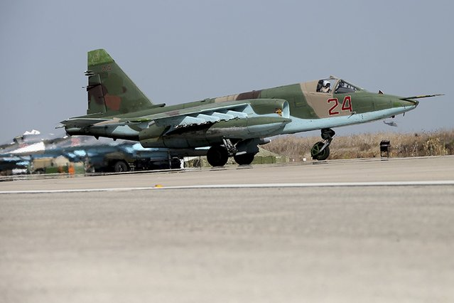 A Sukhoi Su-25 fighter jet taxis on the tarmac at the Hmeymim air base near Latakia, Syria, in this handout photograph released by Russia's Defence Ministry October 22, 2015. (Photo by Reuters/Ministry of Defence of the Russian Federation)