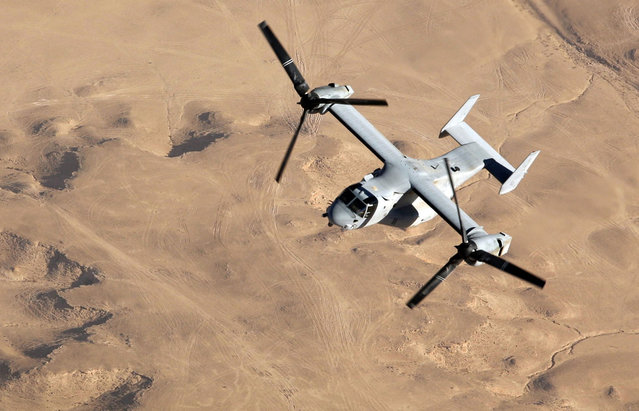 An MV-22B Osprey with Marine Medium Tilt rotor Squadron-263, flies over the Al Anbar Province of Iraq during a mission out of Al Asad Air Base, on November 10, 2007. (Photo by Cpl. Sheila M. Brooks/USMC/The Atlantic)